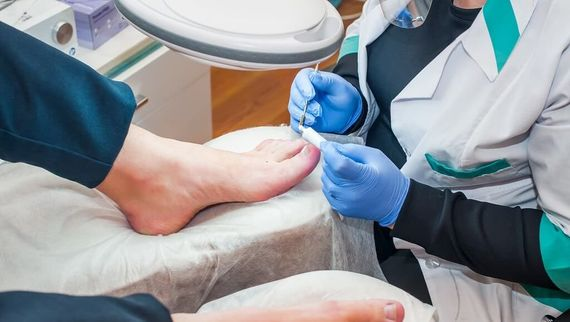 image of our Foot Specialists looking at an foot