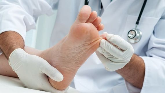 one of our Podiatry & Chiropody looking at an foot